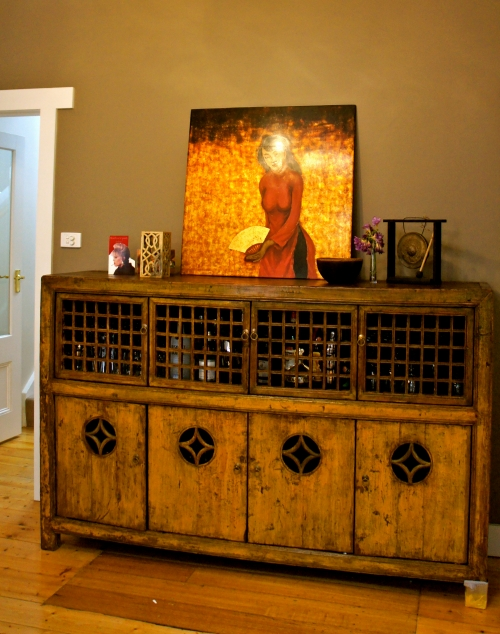 dining room / bar with asian antique cabinet, vietnamese art